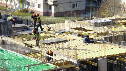 construction workers install construction formwork Live Action