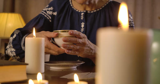 Female Caucasian hands raising coffee cup. Senior unrecognizable prophet reading Live Action