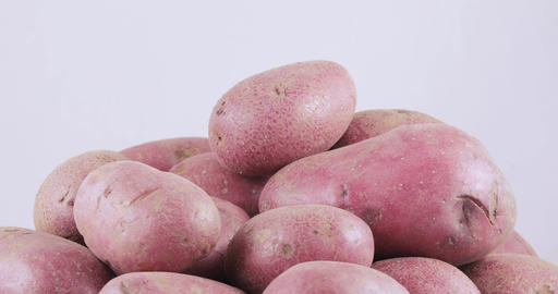 Potatoes red bulk on table Live Action