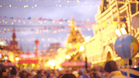 Defocused people in New Year and Christmas Bazaar on the Red Square in Moscow Live Action