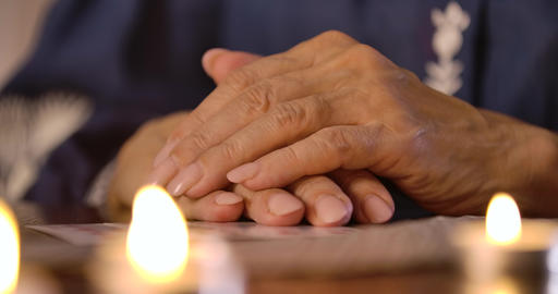 Female Caucasian hands lying on the table on cards, candles lighting at the Live Action