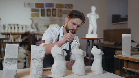 Attractive portrait of serious skilled pleasant bearded sculptor which carefully Live Action