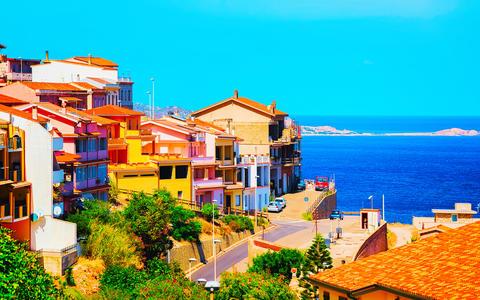 Buggerru city architecture and Mediterranean Sea in South Sardinia reflex Photo