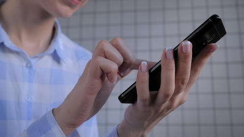 Woman holding smartphone and using voice recognition function - close up view Live Action