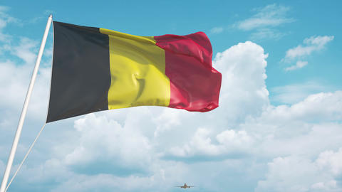Plane arrives to airport with flag of Belgium. Belgian tourism Live Action