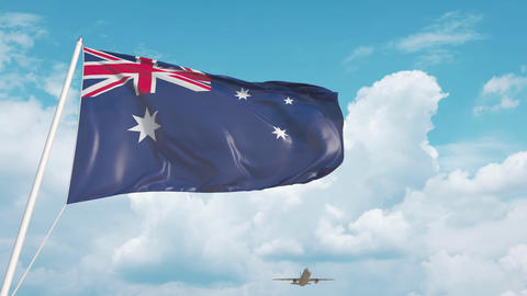 Commercial airplane landing behind the Australian flag. Tourism in Australia Live Action