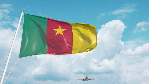 Commercial airplane landing behind the Cameroonian flag. Tourism in Cameroon Live Action