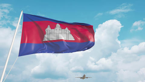 Airliner approaches the Cambodian flag. Tourism in Cambodia Live Action