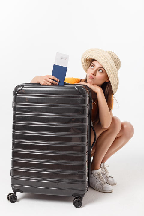 Full length of attractive young female in traveller casual with the travel bag Photo