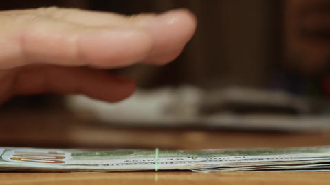 Hand lays banknotes Live Action