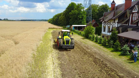 Tractor Working In The Agricultural Field Live Action