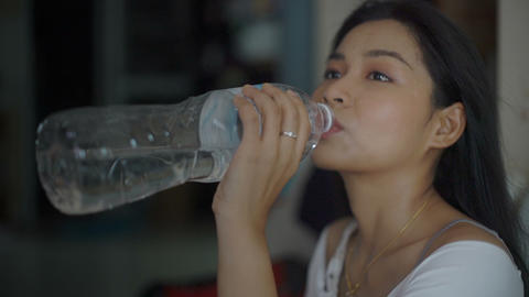 Thai girl is drinking water Live Action