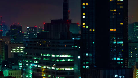 A night timelapse of cityscape at the urban city in Tokyo long shot Live Action