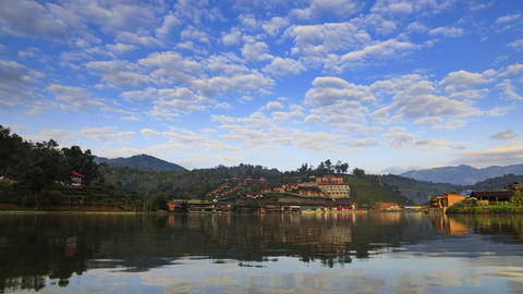 Time-lapse shot scenic landscape of a vintage Chinese traditional style village on the hill with tea ライブ動画