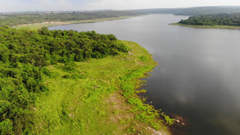 4K Drone shot aerial view scenic landscape of river reservoir beach Acción en vivo