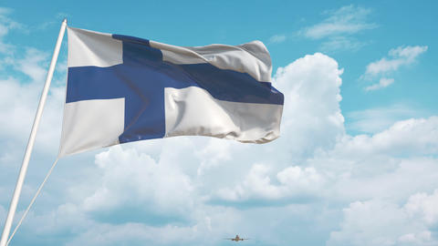 Airliner approaches the Finnish national flag. Tourism in Finland Live Action