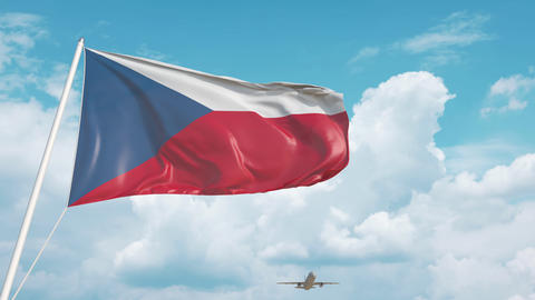 Airliner approaches the Czech national flag. Tourism in Czech Republic Live Action