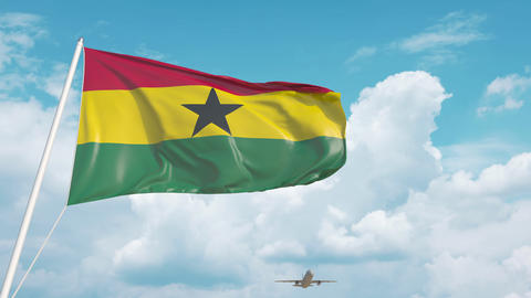 Airliner approaches the Ghanaian national flag. Tourism in Ghana Live Action
