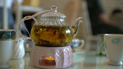 Fresh brewed tea in teapot on a table at cafe Live Action