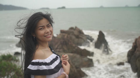Thai Girl with long hair enjoying of breeze from sea Live Action