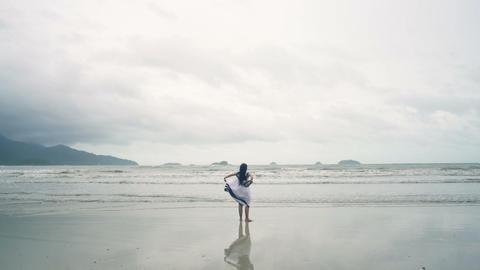 Thai Girl in white dress having fun at beach Live Action