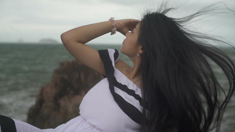 Thai Girl with long hair blowing in the wind from sea Live Action