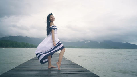 Thai Girl with long hair in white dress on wooden pier Live Action