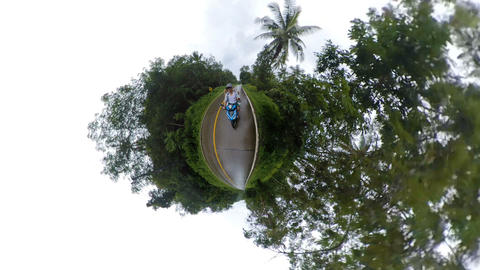 Riding a scooter on tiny little planet Koh Chang island Thailand Live Action
