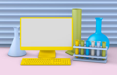 Yellow computer and chemical tubes Photo