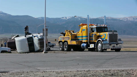 Accident truck trailer rollover tow truck helps HD 2423 Footage