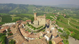 Aerial: flight over beautiful Italian town Serralunga d'Alba and vineyards Filmmaterial
