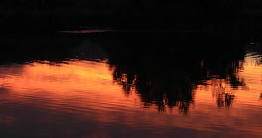 Beautiful red sunset reflection lake water DCI 4K Footage