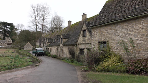 Bibury England Cotswolds cottage along stream 4K Footage