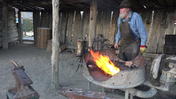 Blacksmith heating steel for manufacture 4K 132 Footage
