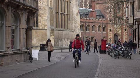 Cambridge England University city students on bikes 4K Footage
