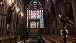 Carlisle Cathedral woman walks from Altar beautiful window England 4K Footage