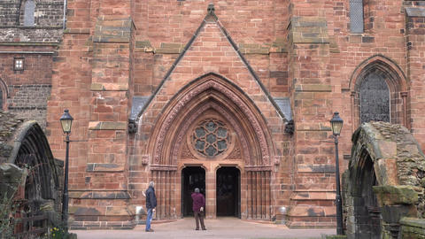 Carlisle England Cathedral senior member entering historic fast 4K Footage