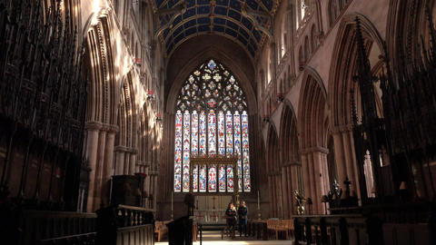 Carlisle England Cathedral women at Altar and stained glass window 4K Footage