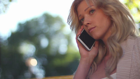 Young woman dials number, receives no answer, hangs up in park Footage