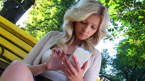 Businesswoman delivering news getting updates on touch phone Footage