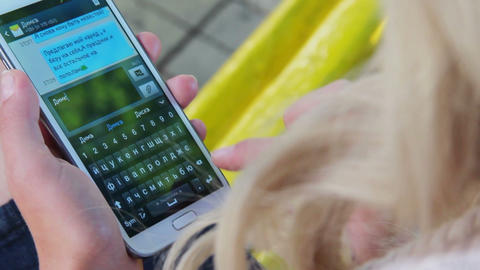 Messages screen on touch phone young woman hands write sms email Footage
