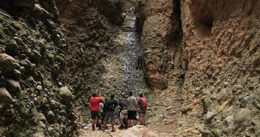 Climbing waterfall end of box canyon scout troop DCI 4K Footage