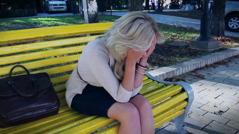 Depression and problems of blond female in park, crying tears Footage
