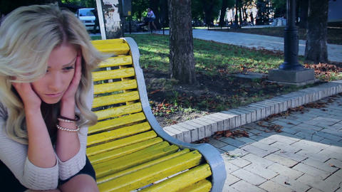 Dolly shot depressed beautiful woman in park, crying broken date Footage