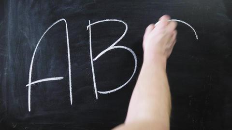 Education concept - ABC alphabet school blackboard concept. School teacher Live Action