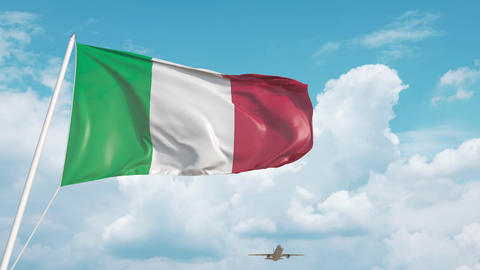 Airliner approaches the Italian flag. Tourism in Italy Live Action