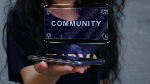 Woman showing HUD hologram Community Live Action