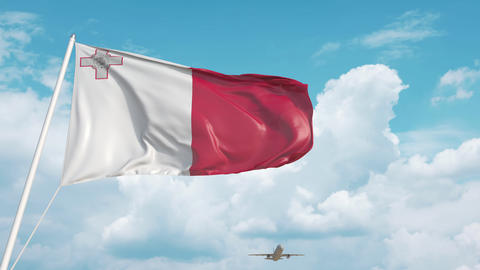 Airliner approaches the Maltese national flag. Tourism in Malta Live Action