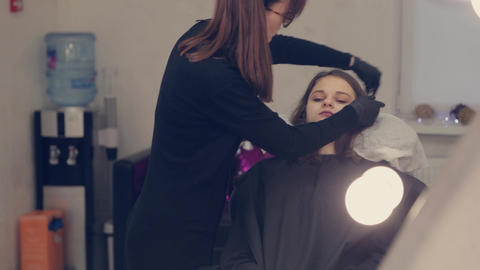 Professional woman eyebrow master cleans eyebrows to client in beauty salon GIF