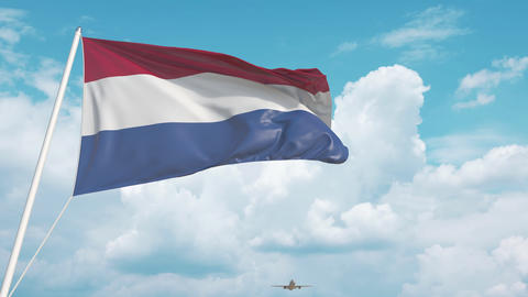 Airliner approaches the Dutch national flag. Tourism in Netherlands Live Action